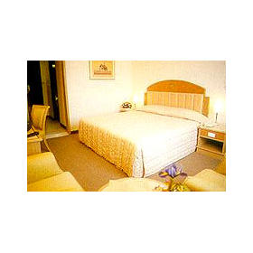 Grand Tower Inn — - Unit Bedroom