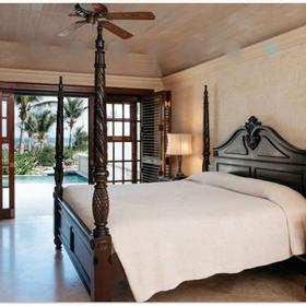The Residences at the Crane Beach Resort — Sample unit master bedroom to the patio with 28ft pool
