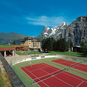 Alpin Palace at a distance; seasonal tennis courts in foreground