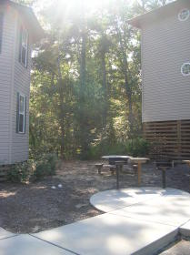 bbq grill and picnic tables outside units